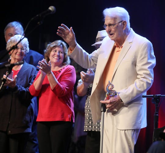 Cliff Smith, 88, waves to the crowd after winning first place at Morning Pointe's Seniors Got Talent competition on Tuesday, Oct. 10, 2018.
