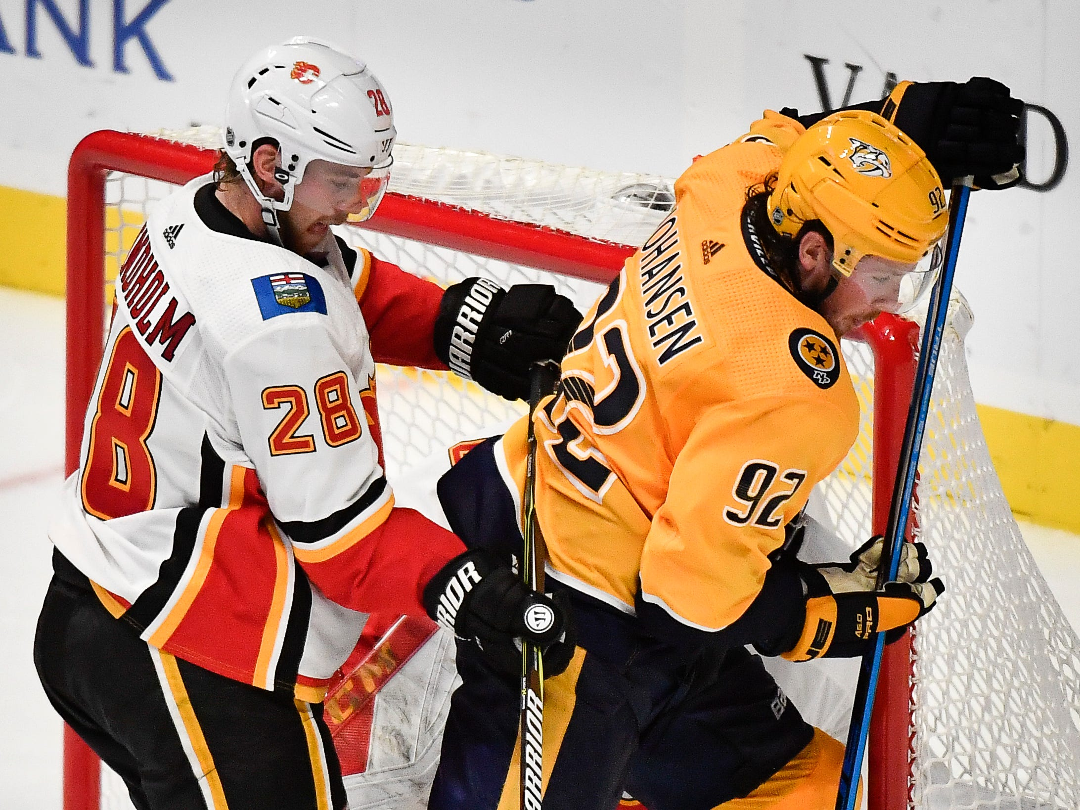 Nashville Predators center Ryan Johansen (92) has his shot on goal stopped by Calgary Flames goaltender Mike Smith (41) and center Elias Lindholm (28) during the third period at Bridgestone Arena Tuesday, Oct. 9, 2018, in Nashville, Tenn.