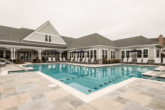 Outdoor amenities at Novel Lockwood Glen include a saltwater pool with a sunshelf, cabanas, a yoga lawn, a dog park and an outdoor kitchen.