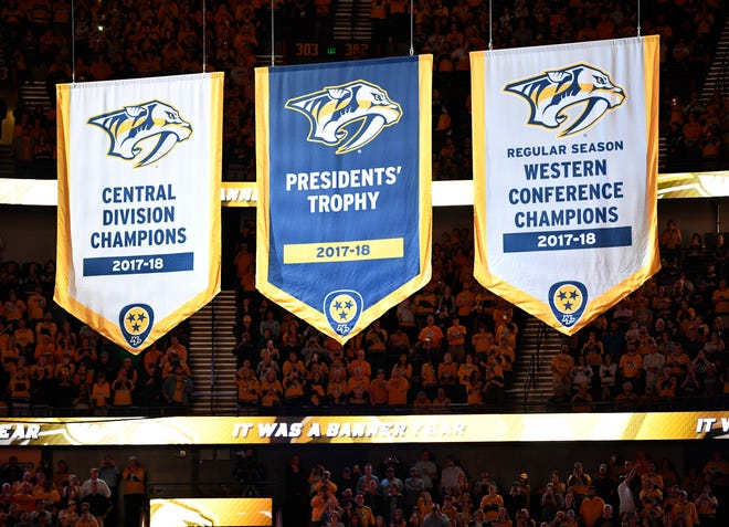The Predators' new banners are raised in pregame ceremonies before the start of the home opener at Bridgestone Arena in Nashville, Tenn., Tuesday, Oct. 9, 2018.