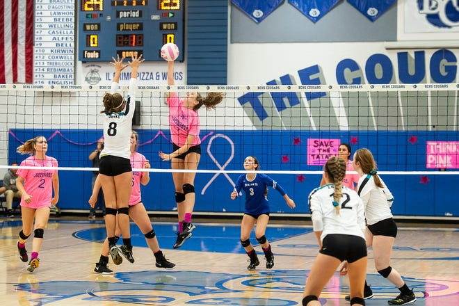 Barron Collier spikes the ball during a match against Gulf Coast High School on Tuesday. The Cougars won in straight sets.
