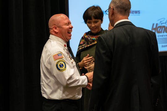 Lt. Kevin Nelmes, left, 2018 Distinguished Public Service Awards Fire Safety recipient, reacts to the comments after the award ceremony at Hilton Naples in Naples, Fla., on Wednesday, Oct. 10, 2018. The Distinguished Public Service Awards recognize the outstanding contribution by an individual or team to their respective public service profession and to the well-being of Collier County. The awards are presented annually by The Greater Naples Chamber of Commerce to honor first responders.