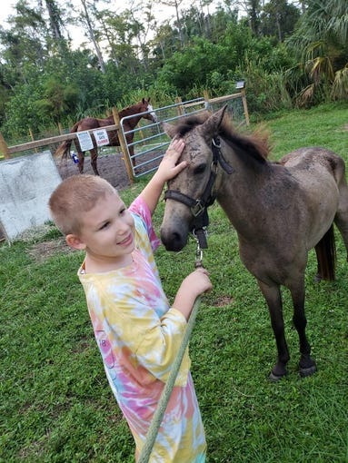 Maximus the pony and Wyatt Stehling, his 6-year-old owner, are pictured. Maximus was killed in a Golden Gate Estates panther attack on Oct. 5, 2018.
