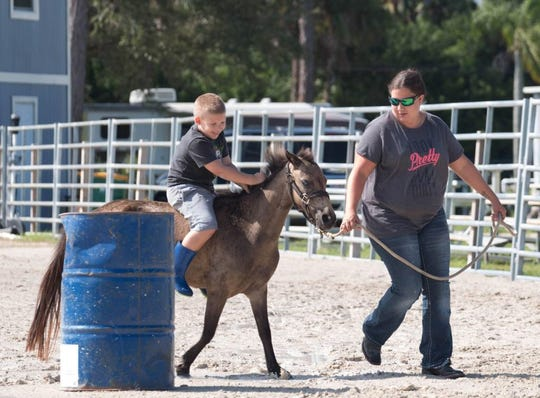 Six-year-old Wyatt Stehling rides on his pony Maximus, while his mother Courtney Stehling guides them. Maximus was killed in a Golden Gate Estates panther attack on Oct. 5, 2018.