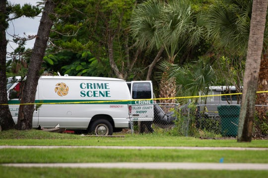 The Collier County Sheriff's Office clears the scene of a death investigation on Tuesday, Oct. 9, 2018, in the 700 block of 102nd Avenue North in Naples Park. The sheriff's office considers the death suspicious.