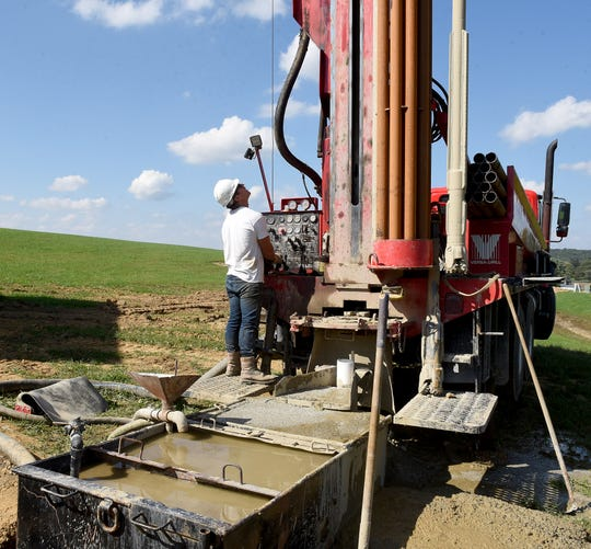 Austin Mount opperates one of Mount Water Well Drilling's rotary drilling rigs at a job site in Heath.