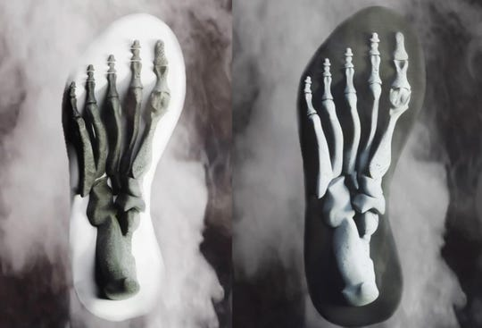 Illustration of the soles of a pair of shoes designed by Former Newark basketball player Jakim Murphy.