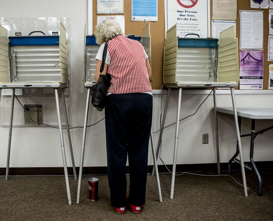 Barbara Lechner fills out her ballot on the first day of early voting at the Licking County Board of Elections.