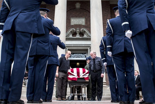 Air National Guard Captain Nathan Richeson's casket was carried out of Swasey Chapel by his brother, Joel, and father, Douglas following Richeson's funeral. Richeson was killed in a roadside crash in August 2014 as a result of suspected distracted driving on the part of the person who struck and killed Richeson while he was changing a tire.