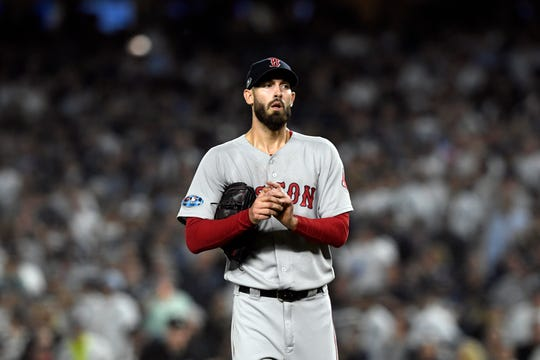 Boston Red Sox pitcher Rick Porcello looks towards his bench after allowing two Yankees players on base in Game 4 of the American League Division Series on Tuesday, Oct. 9, 2018, in New York.