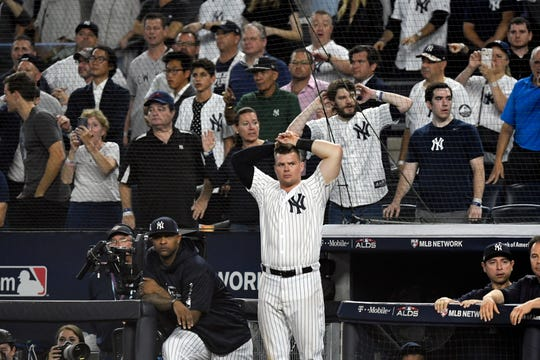 New York Yankees' CC Sabathia, left, and Luke Voit react as they lose the American League Division Series to the Boston Red Sox, 4-3, on Tuesday, Oct. 9, 2018, in New York.