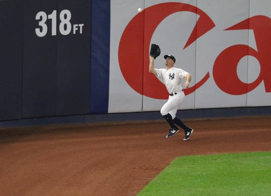 Brett Gardner caught this fly ball on the warning track with the bases loaded to end the top of the first inning. Tuesday, October 9, 2018