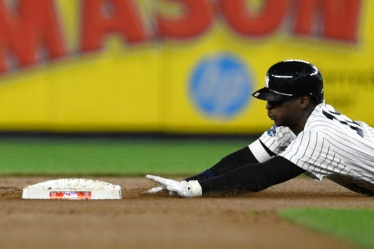 New York Yankees' Didi Gregorius slides safely into second base in Game 4 of the American League Division Series on Tuesday, Oct. 9, 2018, in New York.