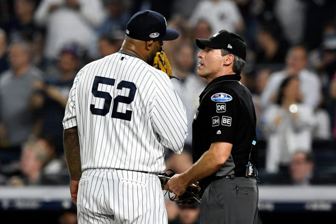New York Yankees pitcher CC Sabathia (52) speaks to umpire Angel Hernandez in the first inning of Game 4 of the American League Division Series on Tuesday, Oct. 9, 2018, in New York.