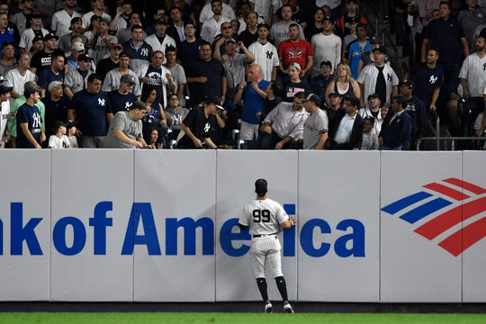 New York Yankees' Aaron Judge (99) watches a homerun ball hit by Boston Red Sox's Christian Vazquez (not pictured) in the fourth inning of Game 4 of the American League Division Series on Tuesday, Oct. 9, 2018, in New York.