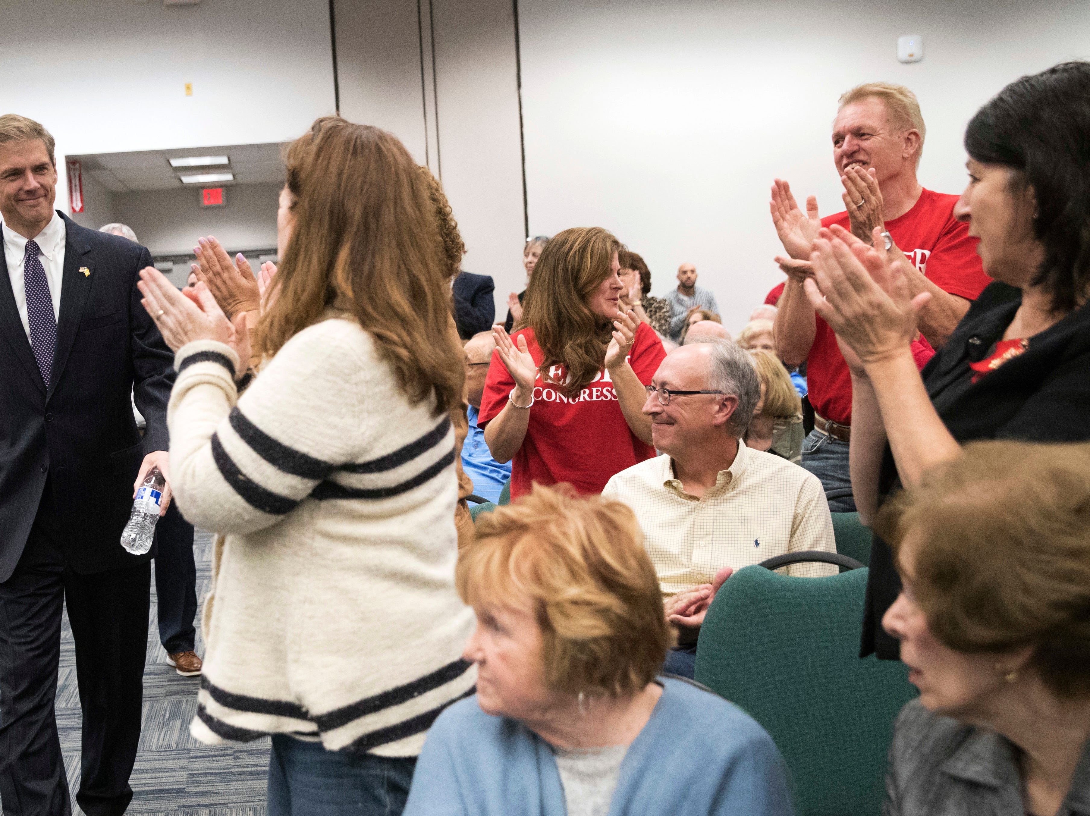 Supporters of Republican Assemblyman Jay Webber cheer as he arrives for a candidate forum at the UJC of MetroWest New Jersey, Tuesday, Oct. 9, 2018, in Whippany, N.J. (AP Photo/Mary Altaffer)