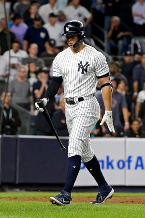 Oct 9, 2018; Bronx, NY, USA; New York Yankees designated hitter Giancarlo Stanton (27) reacts after striking out during the ninth inning against the Boston Red Sox in game four of the 2018 ALDS playoff baseball series at Yankee Stadium.
