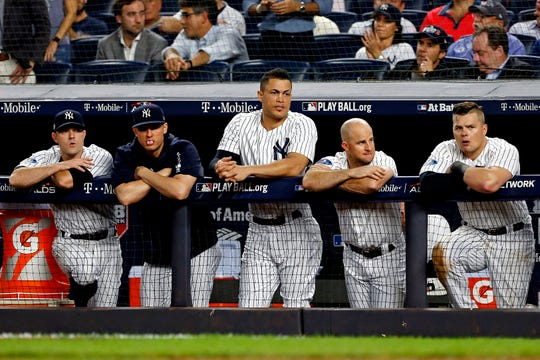 Oct 9, 2018; Bronx, NY, USA; The New York Yankees dugout reacts during the eighth inning against the Boston Red Sox in game four of the 2018 ALDS playoff baseball series at Yankee Stadium.