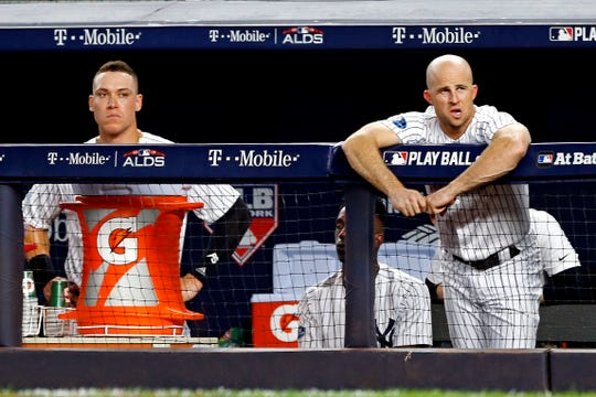 Oct 9, 2018; Bronx, NY, USA; New York Yankees left fielder Brett Gardner (11) and right fielder Aaron Judge (99) in the dugout during the sixth inning in game four of the 2018 ALDS playoff baseball series at Yankee Stadium.