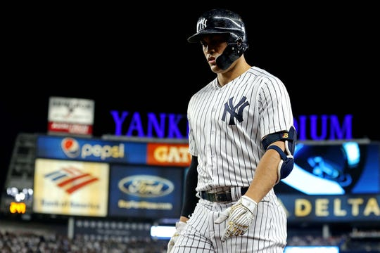 Oct 9, 2018; Bronx, NY, USA; New York Yankees designated hitter Giancarlo Stanton (27) reacts during the sixth inning against the Boston Red Sox in game four of the 2018 ALDS playoff baseball series at Yankee Stadium.