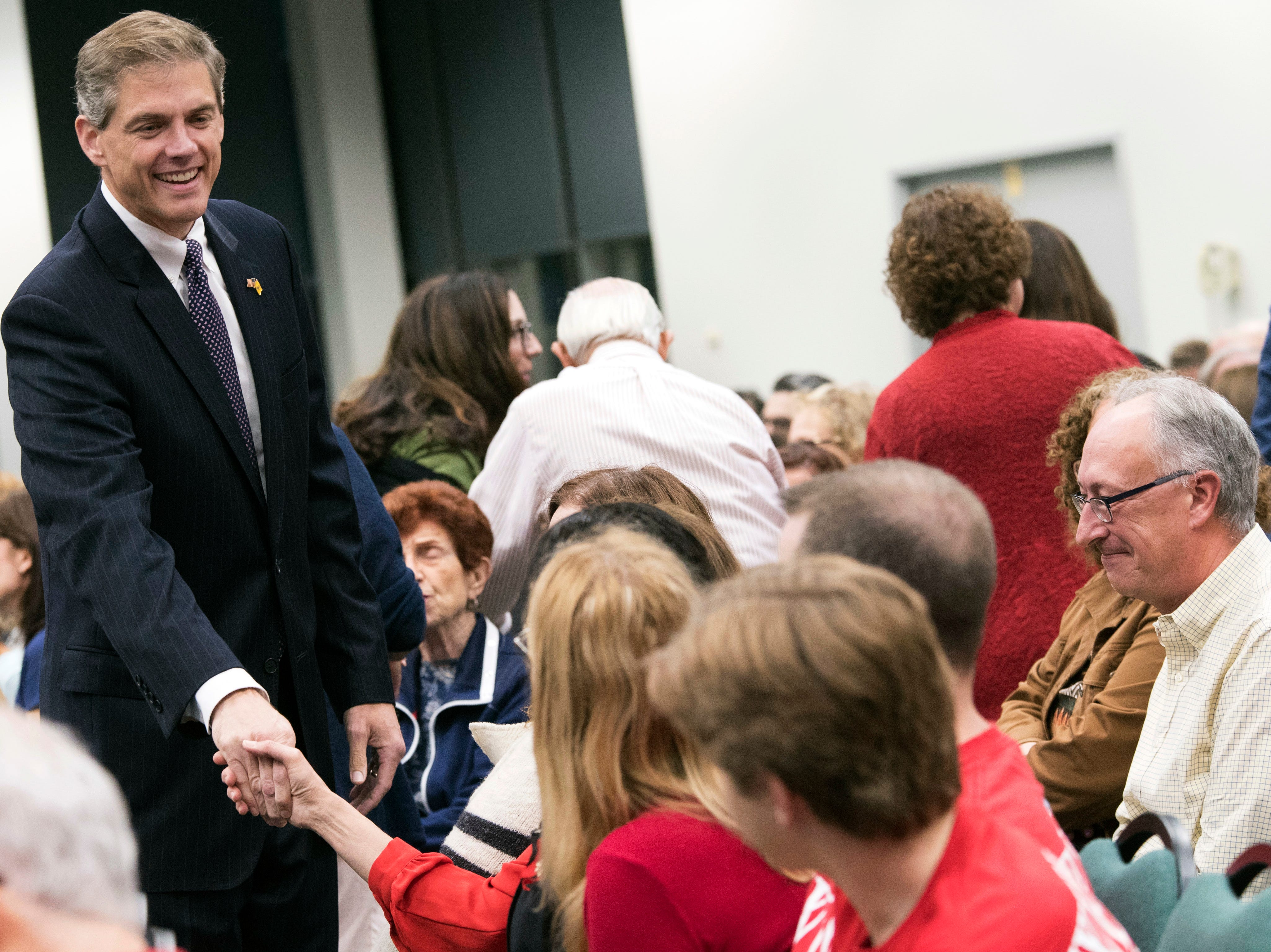Republican Assemblyman Jay Webber greets voters during a candidate forum at the UJC of MetroWest New Jersey, Tuesday, Oct. 9, 2018, in Whippany, N.J. (AP Photo/Mary Altaffer)