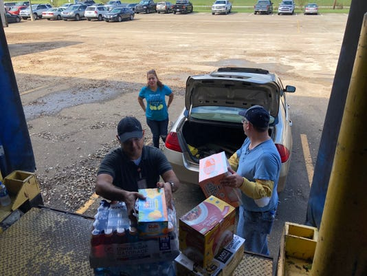 Gaf Employees Picking Up Relief Supplies From The Plant