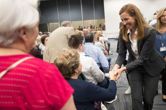 Democratic congressional candidate Mikie Sherrill greets voters during a candidate forum at the UJC of MetroWest New Jersey, Tuesday, Oct. 9, 2018, in Whippany, N.J. (AP Photo/Mary Altaffer)
