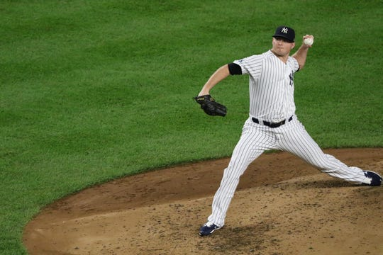 Zach Britton pitches in relief for the Yankees in the fourth inning.  Tuesday, October 9, 2018