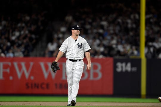 New York Yankees pitcher Zack Britton (53) reacts after missing a play on the ball allowing a Boston Red Sox running to get to first in Game 4 of the American League Division Series on Tuesday, Oct. 9, 2018, in New York.