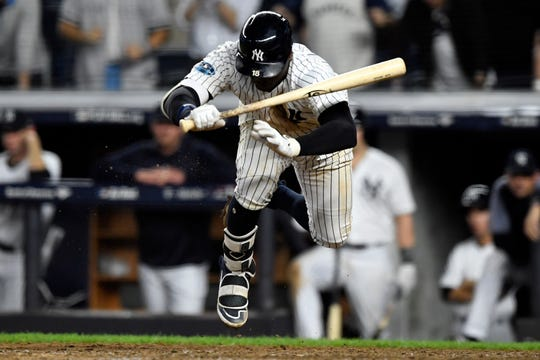 New York Yankees' Didi Gregorius jumps to avoid a wild pitch in the ninth inning in Game 4 of the American League Division Series on Tuesday, Oct. 9, 2018, in New York.
