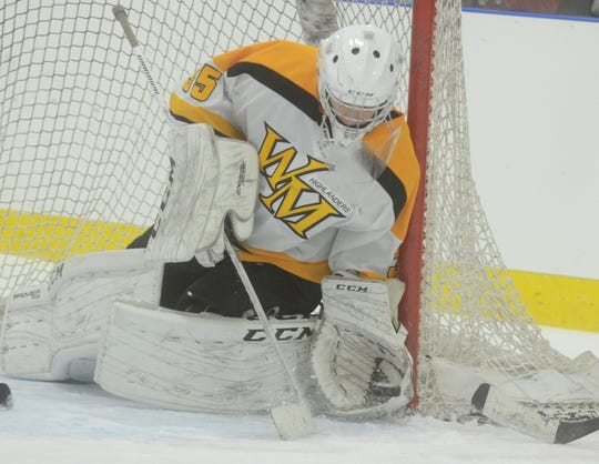 West Milford goalie Nick Johansson with one of his many saves in a game against Lakeland Dec. 9, 2016