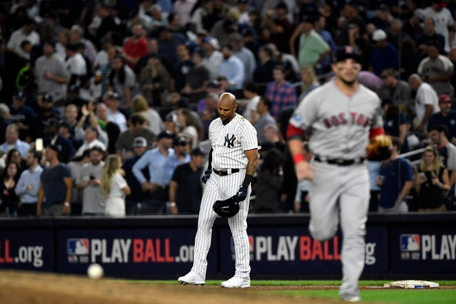 New York Yankees' Aaron Hicks reacts after hitting a fly ball for an out to end the inning in Game 4 of the American League Division Series on Tuesday, Oct. 9, 2018, in New York.