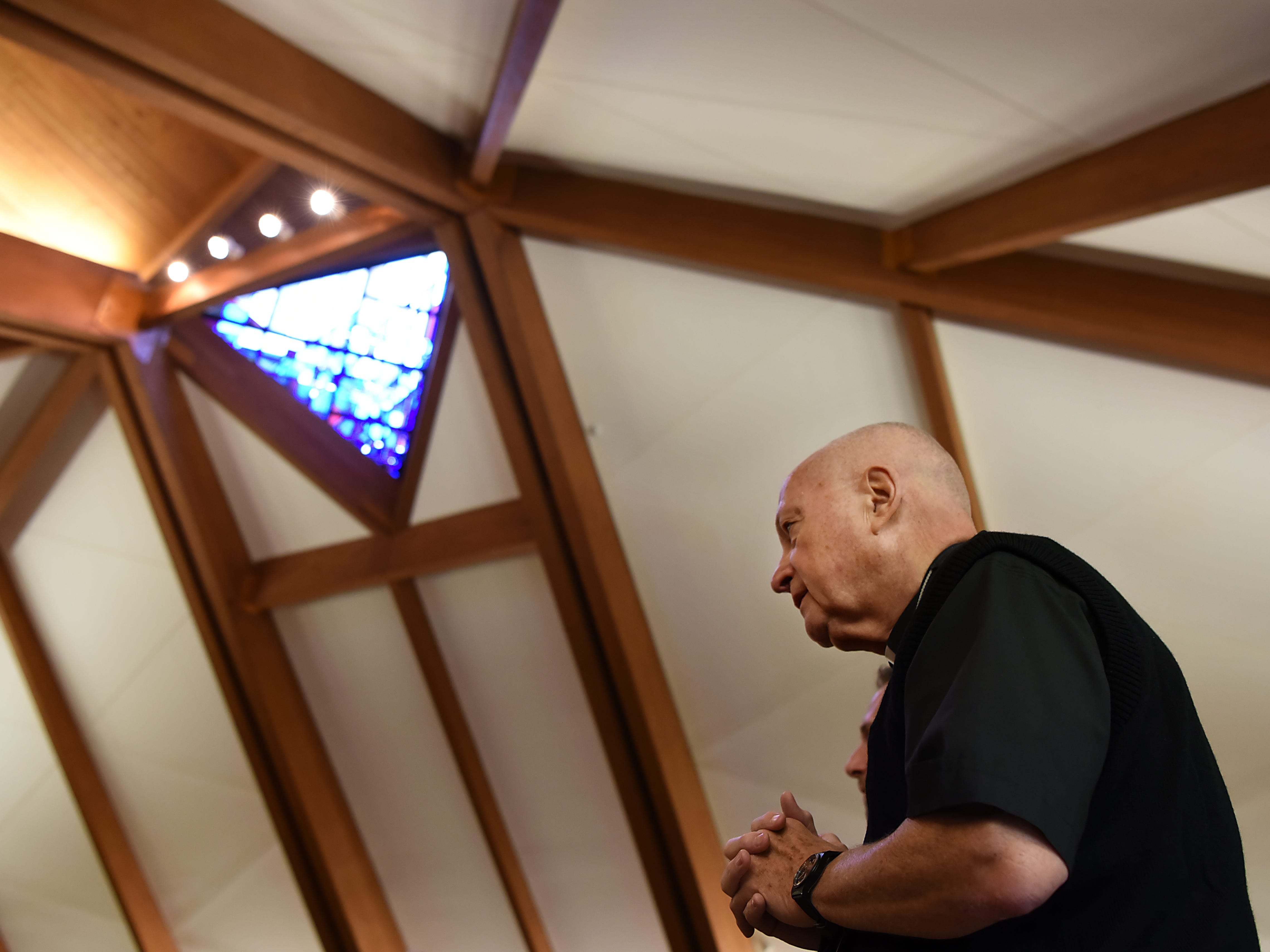 The Straight and Narrow Choir performs at Our Lady of the Magnificat Church in Kinnelon on Sunday September 23, 2018. Father Bill Naughton clasps his hands together in prayer during the mass.