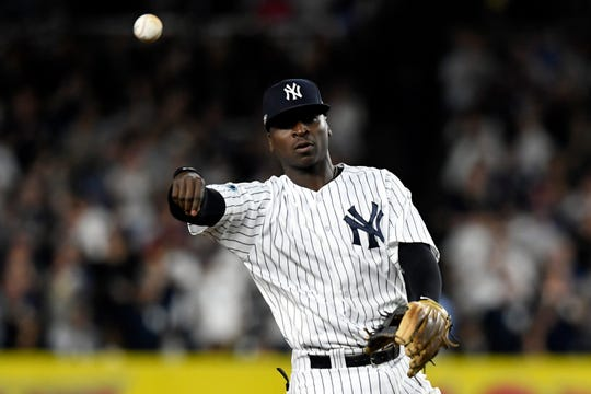 New York Yankees' Didi Gregorius throws to New York Yankees? Neil Walker, not pictured, in between outs in Game 4 of the American League Division Series on Tuesday, Oct. 9, 2018, in New York.