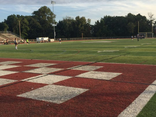 The artificial turf field at Wayne Hills High School is used by several athletic teams, including the school's field hockey squad, shown here during a match against Hackensack on Oct. 9.