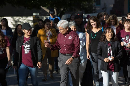 Dan Arvizu, Chancellor of New Mexico State University, leads the walk from Hadley Hall to Corbett Center to celebrate exercise as medicine, while talking to Brenda Jimenez, an undergraduate in the public health administration program, Wednesday October 10, 2018. Other students and faculty from the public health department joined in on the walk that was hosted by Aggie Health and Wellness and the undergraduate public health students.