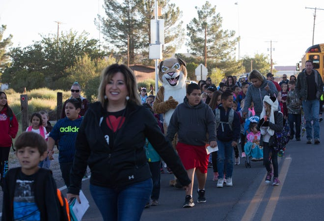 Students from Doña Ana Elementary School participated in International Walk to School Day on Wednesday, Oct. 10, 2018, walking from the Doña Ana baseball field to Doña Ana Elementary School. Students from around Las Cruces Public Schools participated in the global event, which is meant to act as a way to living healthier lives, decreasing pollution, and raising awa