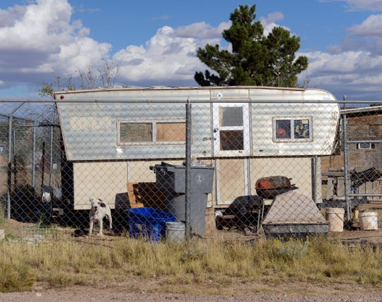 A couple live in this travel trailer next to the lot in Chaparral where the Espinos want to erect a mobile home for their grandmother, but have been told they can't.
