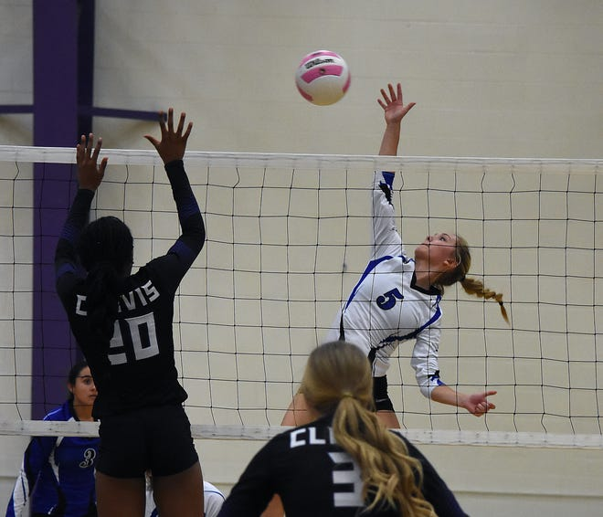 Carlsbad outside hitter Alexa Sowers hits one over the next in the second set of Tuesday's District 4-5A match at Rock Staubus Gymnasium in Clovis. The host Wildcats topped Carlsbad in three.