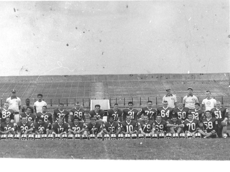 The 1963/1964 Cavemen Football Team posed on the field with three coaches and three managers. Only Coaches Joe Willis and Ralph Bowyer are known.