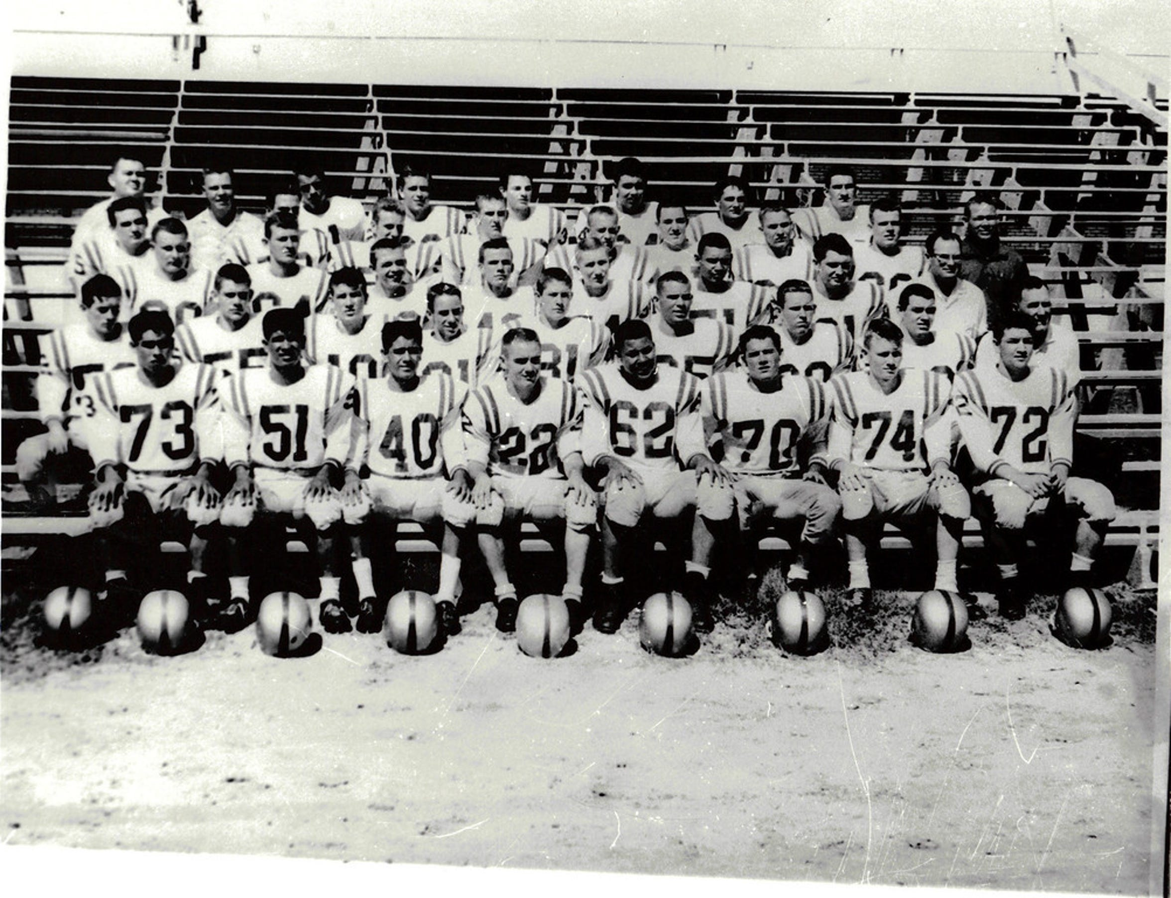 The Carlsbad Cavemen 1956/1957 football team posed in uniform, in the bleachers. Only the three coaches are known: Head Coach Ralph Bowyer and Assistant Coaches Joe Stell and Joe Willis New Mexico Carlsbad.