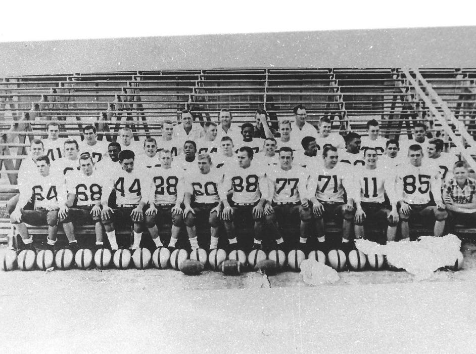 The 1957/1958 Cavemen Football Team  posed in the bleachers with four coaches and a manager. Only Coaches Ralph Bowyer, Joe Willis and Joe Stell are known.