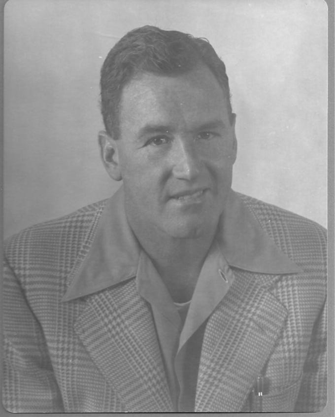 1954 studio portrait of CHS Head Football Coach Ralph Bowyer (40) in open sports shirt and sports coat via the New Mexico Carlsbad Bob Nymeyer Photo Collection.