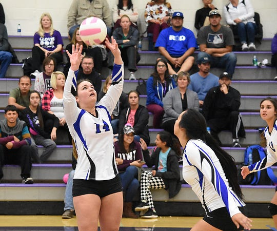 Carlsbad senior Danaye Boss sets the ball for an incoming Serena Rodriquez in the second set of Tuesday's match.