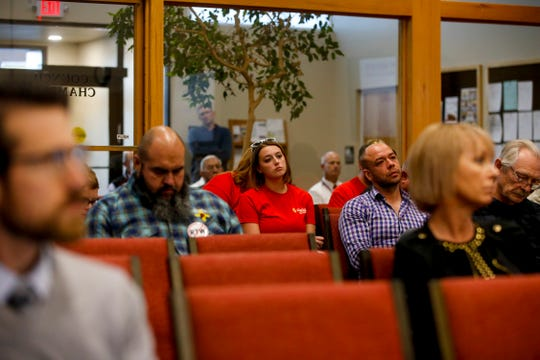 Community members listen during a Farmington City Council meeting Tuesday at City Hall.