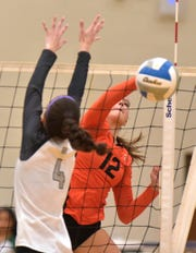 Northville Mustang Jenna Boksha (12) gets the ball past Novi defender Shannon Jennings.