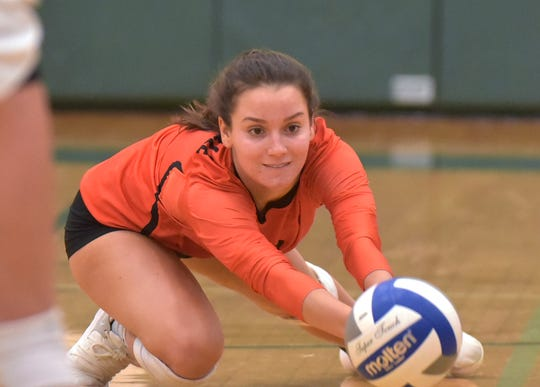 Mustang Ally Zayan (6) digs for the ball but can't get a big enough piece.