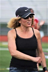 Deanna Wile was a bundle of energy who had a passion for running and the athletes she coached.