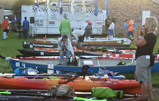 Canoes and kayaks await the start of the opening ceremony for the annual Tour du Teche canoe and kayak races starting in Port Barre.