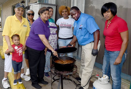 Connie Shakesnider, family, friends and volunteers preparing a pork stew for their annual Feed the Elderly Day assisted by Med Express Ambulance Service and I-49 Riders.